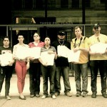 Members of the Cruz family and Occupy Homes MN hold up petitions of support signed by 175,000 people. Photo: Occupy Homes MN