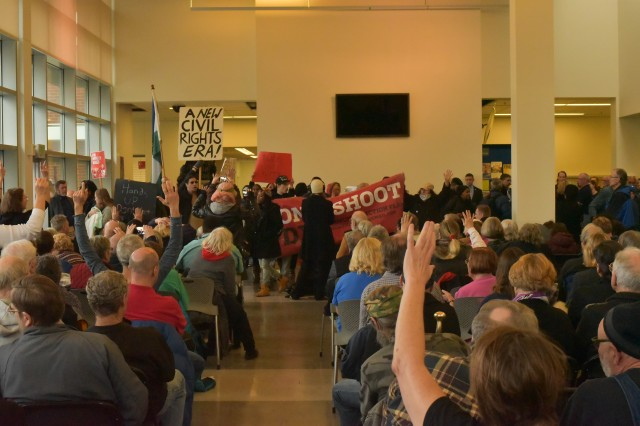 Protesters Disrupt Wyden Town Hall Meeting; Hold Their Own When Wyden Runs