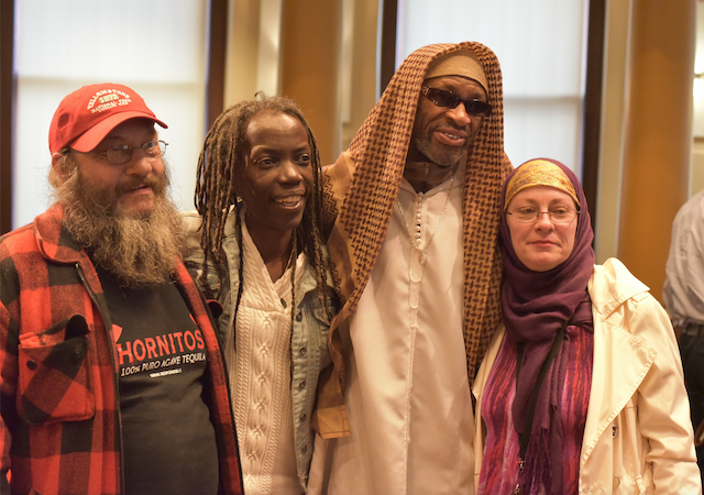 Brad Gibson, JoAnn Hardesty, Ibrahim Mubarak, and Lisa Fay after the resolution passed. Photo by Pete Shaw.