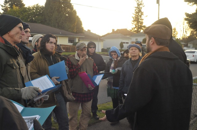 Supporters prepare to canvass residents living on the blocks surrounding Debbie and Ron Austin's house, informing them of the Austins' eviction, what they could do to fight back, and signing them up for the We Are Oregon Rapid Response Network.
